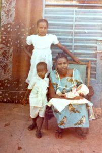 Abdou with his family in Burkina Faso (1990)