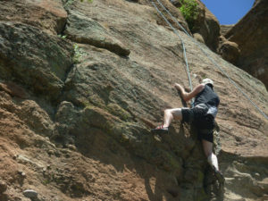 Chris on one of his early rock climbs (circa 2010)