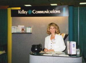 Laurie representing her own company at an industry conference in 1996
