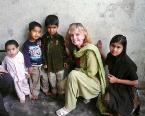 Laurie bonding with children of a family affected by haemophilia in Pakistan (2012)