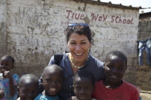 Flora pictured on a humanitarian aid trip in Zambia.